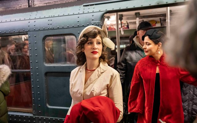 People take a ride in a vintage subway car during Holiday Nostalgia Rides in New York's subway, the United States, December 8, 2019. Every Sunday between Thanksgiving and New Year, vintage 1930s R1-9 train cars would be placed in regular New York City subway service on specific routes during the annual Holiday Nostalgia Rides, taking passengers back into old times. (Photo by Wang Ying/Xinhua News Agency)