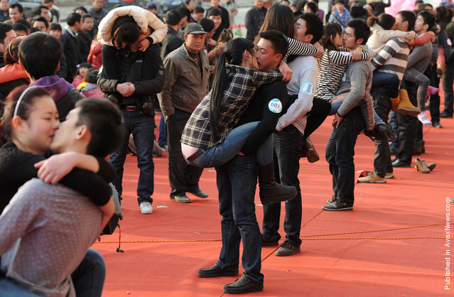 Couples participate in a kissing contest in Hefei, Anhui province, China