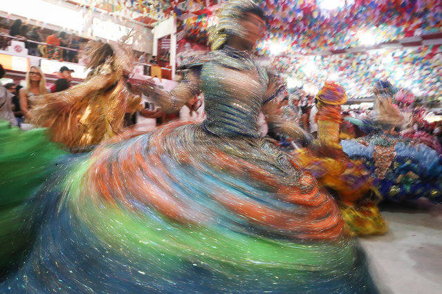 Dancers are blurred performing during a traditional Festas Juninas (June Festivals) party at the Salgueiro samba school on June 18, 2017 in Rio de Janeiro, Brazil. Rio Mayor Marcelo Crivella, a religious conservative, has announced plans to cut funding for the famed samba school Carnival parades by fifty percent for the 2018 Carnival amidst an economic crisis in the city. Organizers from the samba schools announced if they don't receive proper funding they will have to cancel the parades for 2018. Carnival annually draws around 1 million tourists to Rio. (Photo by Mario Tama/Getty Images)