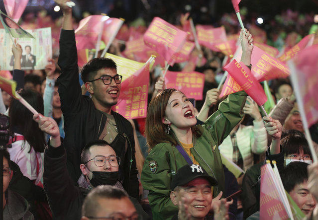 Supporters of Taiwan's 2020 presidential election candidate, Taiwan president Tsai Ing-wen cheer for Tsai's victory in Taipei, Taiwan, Saturday, January 11, 2020. (Photo by Chiang Ying-ying/AP Photo)