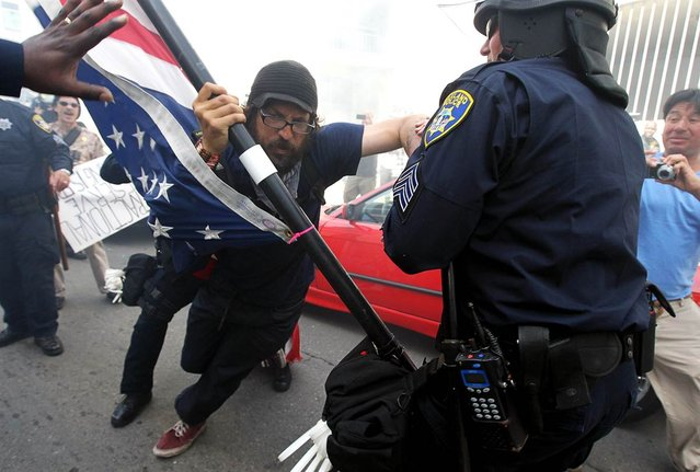 Oakland police officers detain an Occupy protester who was attempting to block a street on May 1, in Oakland, Calif. Occupy Wall Street groups across the country joined with unions on May Day, a traditional day of global demonstrations supporting unions and leftist politics