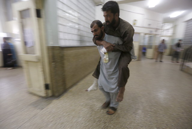 An Afghan man is carried out of a hospital after receiving treatment following a suicide truck bomb attack in Kabul, Afghanistan August 7, 2015. The bombings were the first in Kabul since Mullah Akhtar Mansour took charge of the Taliban last week, and followed a rare truck bomb attack in an eastern province on Thursday. (Photo by Omar Sobhani/Reuters)