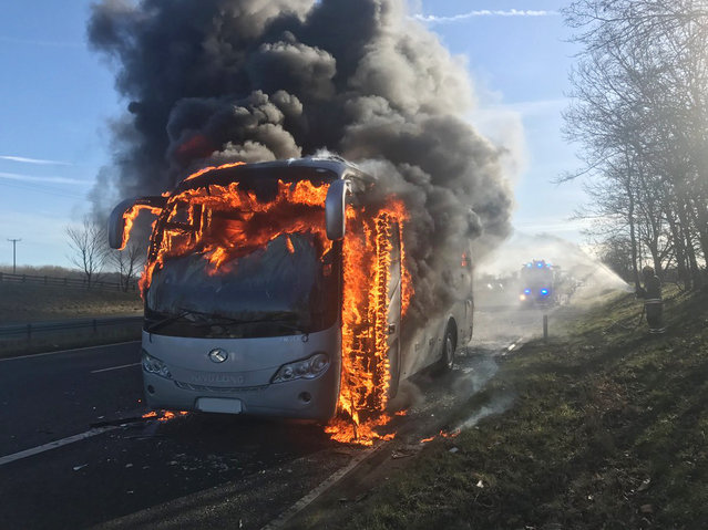 A photo taken by a member of the County Durham and Darlington fire and rescue Service of a coach on fire on the A1 in County Durham, England on March 2, 2017. Passengers were evacuated safely before flames engulfed the vehicle. (Photo by County Durham and Darlington Fir/PA Wire)