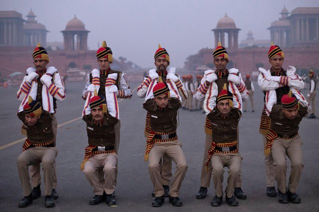 Members of Delhi Police stretch before the rehearsal for the Republic Day parade early morning in New Delhi, India, January 13, 2020. (Photo by Danish Siddiqui/Reuters)