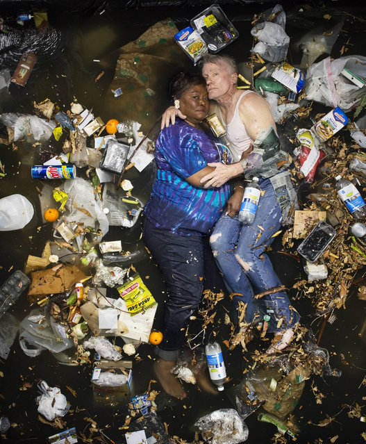 Marsha and Steve surrounded by seven days of their own rubbish in Pasadena, California. (Photo by Gregg Segal/Barcroft Media)