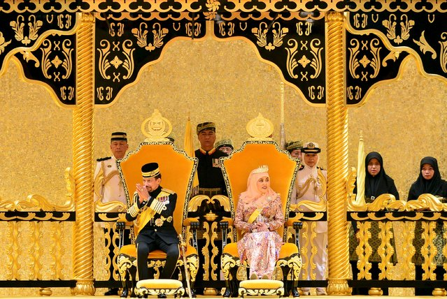 Brunei's Sultan Hassanal Bolkiah (L) sits next to Queen Saleha (R) during his 69th birthday celebration in Nurul Iman palace in Bandar Seri Begawan, Brunei, August 15, 2015. Brunei's Sultan Hassanal Bolkiah was born on July 15, 1946. (Photo by Ahim Rani/Reuters)