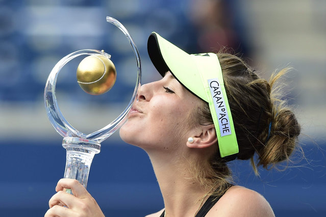 Belinda Bencic, of Switzerland, kisses the winner's trophy after defeating Simona Halep, of Romania, in the women's final at the Rogers Cup tennis tournament in Toronto, Sunday, August 16, 2015. (Photo by Frank Gunn/The Canadian Press via AP Photo)