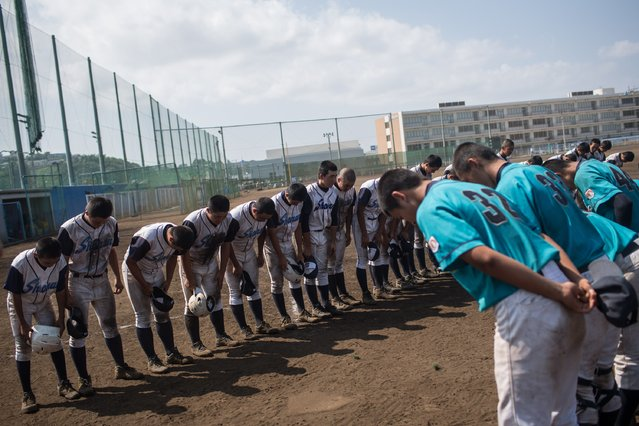 Players bow to the diamond after finishing play during a practice game between the Shonan Boys and the Yokohama Minami on July 30, 2014 in Yokosuka, Japan. The games were the final practice session for the teams, before heading to the National Tournament starting on August 2. (Photo by Chris McGrath/Getty Images)