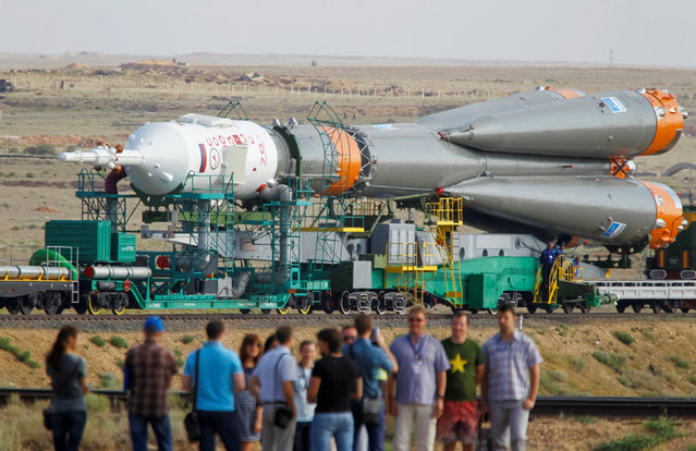 The Soyuz MS spacecraft for the next International Space Station (ISS) crew of Kate Rubins of the U.S., Anatoly Ivanishin of Russia and Takuya Onishi of Japan is transported from an assembling hangar to the launchpad ahead of its launch scheduled on July 7, at the Baikonur cosmodrome in Kazakhstan July 4, 2016. (Photo by Shamil Zhumatov/Reuters)