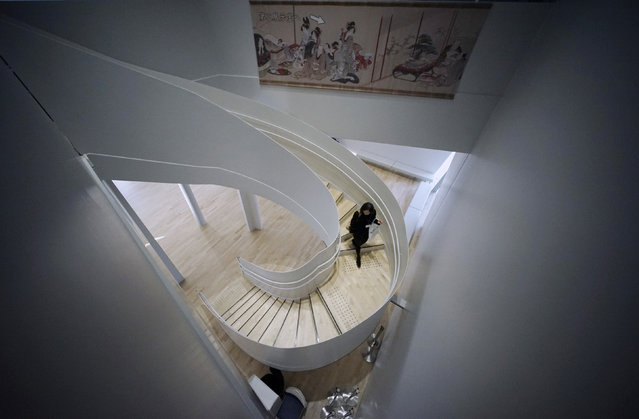 In this November 18, 2016 photo, a guest walks down the stairs during a press preview of the Sumida Hokusai Museum at Tokyo's Sumida Ward. The museum dedicated to Japanese woodblock print artist Katsushika Hokusai, creator of some of the most iconic art of the genre, opened Tuesday in the neighborhood he lived in some two centuries ago. (Photo by Eugene Hoshiko/AP Photo)