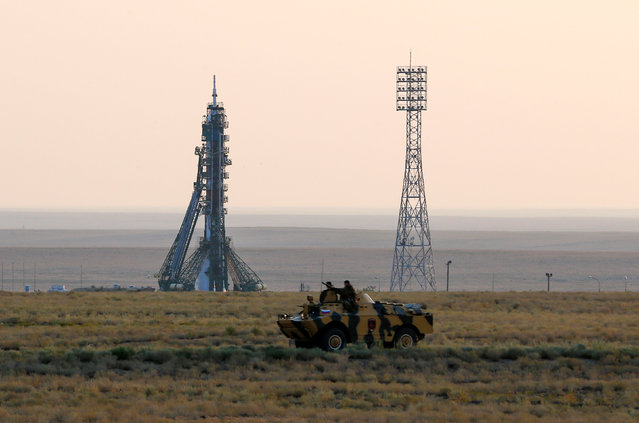 Policemen ride an armoured vehicle in front of the Soyuz MS spacecraft shortly before its launch with the International Space Station (ISS) crew of Kate Rubins of the U.S., Anatoly Ivanishin of Russia and Takuya Onishi of Japan at the Baikonur cosmodrome, Kazakhstan, July 7, 2016. (Photo by Shamil Zhumatov/Reuters)