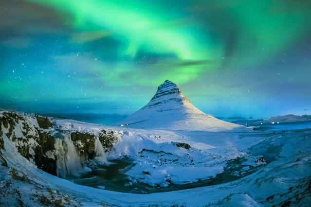 Northern lights over Mount Kirkjufell, Iceland on February 2, 2015. (Photo by Moment RF via Getty Images)