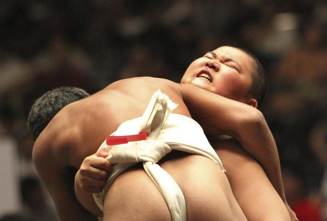LaPresseIn this Sunday, July 29, 2012 photo, an elementary school sumo wrestler reacts after his bout at the National Children's Sumo tournament in Tokyo.