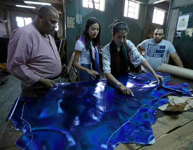 "Co-founders of local brand ""Okhtein"", sisters Aya and Mounaz Abdelraouf, check leather's quality at a tannery in Cairo, Egypt May 26, 2016. (Photo by Mohamed Abd El Ghany/Reuters)"