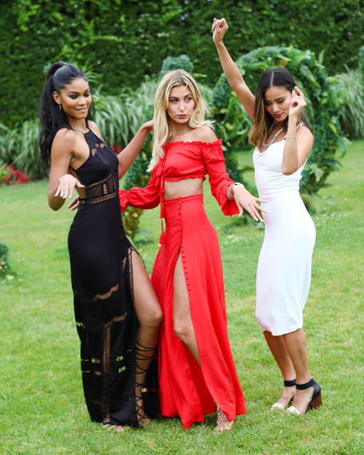 """Chanel Iman, Hailey Baldwin and Jamie Chung party it up for the launch of Moët & Chandon's Rosé Impérial """"Pink Flamingo"""" Bottle at the REVOLVE Hamptons House, New York on July 15, 2016. (Photo byDavid X. Prutting/BFA.com)"""