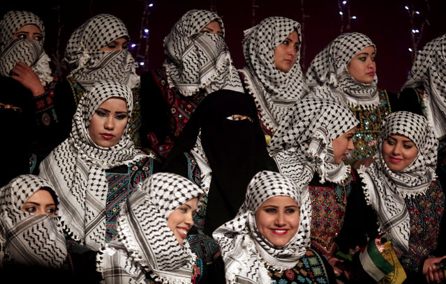 Palestinian brides wearing traditional headscarves attend a mass wedding ceremony on the beach of Gaza City, Tuesday, February 4, 2014. Forty couples took part in the event which was organized by Palestinian President Mahmoud Abbas' Fatah movement. (Photo by Hatem Moussa/AP Photo)