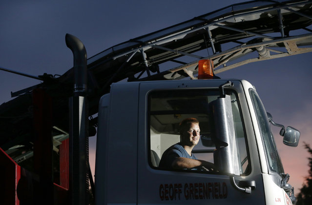 Heavy goods vehicle driver Philip Francis poses for a photograph at the Geoff Greenfield yard in Upper Beeding, near Steyning in southern England July 21, 2014. (Photo by Luke MacGregor/Reuters)