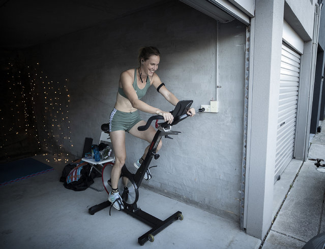 Australian Olympic Swimmer Bronte Campbell trains on a bike while on a Zoom training call with her sister Cate Campbell and other members of her swim team at her home on April 24, 2020 in Sydney, Australia. Athletes across the country are now training in isolation under strict policies in place due to the Covid-19 pandemic. (Photo by Ryan Pierse/Getty Images)