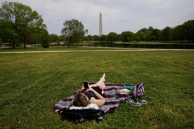 Chelsea Bruchs enjoys a nice day on the National Mall as the coronavirus disease (COVID-19) pandemic continues in Washington, U.S., April 29, 2020. (Photo by Kevin Lamarque/Reuters)