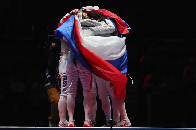 Russia celebrates winning gold after the Women's Sabre Team gold medal match between Russia and Ukraine on Day 8 of the Rio 2016 Olympic Games at Carioca Arena 3 on August 13, 2016 in Rio de Janeiro, Brazil. (Photo by Tom Pennington/Getty Images)