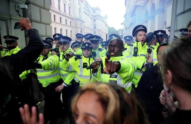Police clash with demonstrators on Whitehall during a Black Lives Matter protest in London, following the death of George Floyd who died in police custody in Minneapolis, London, Britain, June 7, 2020. (Photo by Hannah McKay/Reuters)