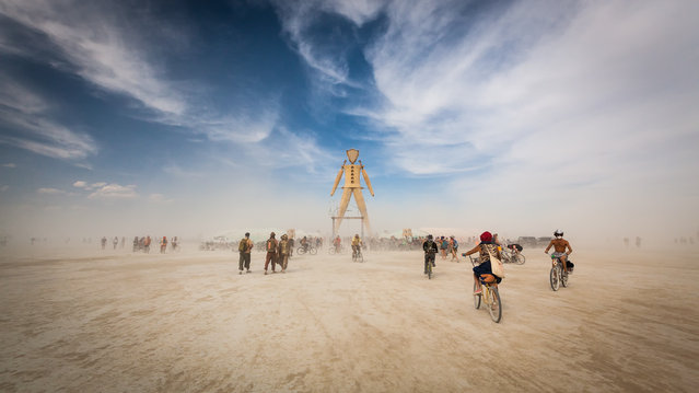 """""""The Man"""". People traveled from all over the world to Burning Man to gather at the Man's feet. A symbol that meant something different to every single individual. A group of my campmates and I made the journey via our art car this afternoon. It was the first time I experienced a dust storm whiteout. (Photo and caption by Lace Andersen/National Geographic Photo Contest)"""