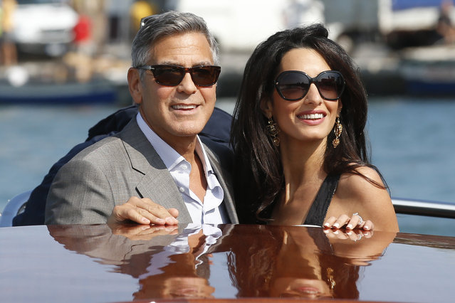 George Clooney, left, and Amal Alamuddin arrive in Venice, Italy, Friday, September 26, 2014. Clooney, 53, and Alamuddin, 36, are expected to get married this weekend in Venice, one of the world's most romantic settings. (Photo by Luca Bruno/AP Photo)