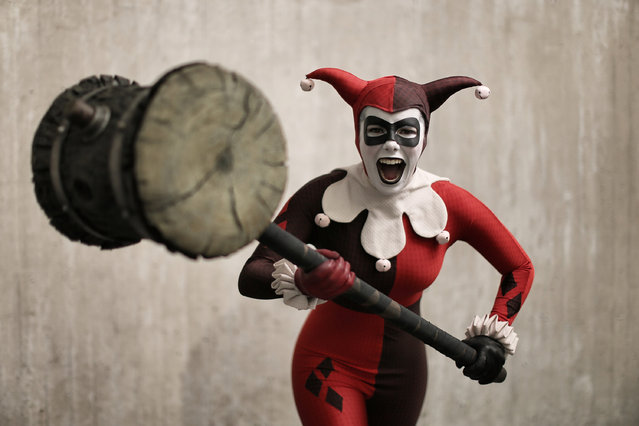 Comic Con attendee Alyssa King poses as Harlequin during the 2014 New York Comic Con at Jacob Javitz Center on October 10, 2014 in New York City. (Photo by Neilson Barnard/Getty Images)