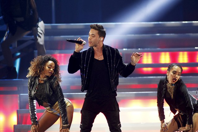 Prince Royce (C) performs with dancers during the second night of the 2015 iHeartRadio Music Festival at the MGM Grand Garden Arena in Las Vegas, Nevada September 19, 2015. (Photo by Steve Marcus/Reuters)
