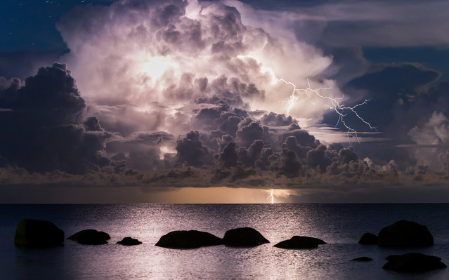 """Lightning"". Lightning in Vergi Port. Photo location: Estonia. (Photo and caption by Kristjan Madalvee/National Geographic Photo Contest)"
