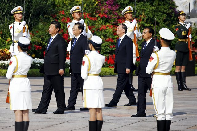 Chinese President Xi Jinping, Chairman of the Standing Committee of the National People's Congress (NPC), Zhang Dejiang, China's Politburo Standing Committee member Wang Qishan, and Chinese Premier Li Keqiang (L-R) walk towards the Monument to the People's Heroes during a tribute ceremony ahead of National Day marking the 66th anniversary of the founding of the People's Republic of China in Beijing September 30, 2015. (Photo by Damir Sagolj/Reuters)