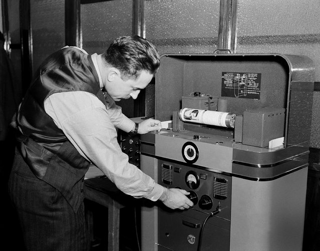 A radio engineer runs a test on facsimile broadcasting apparatus of the Post Dispatch in St. Louis, Missouri, December 7, 1938, before regular daily broadcasts of news began over W9XZY on ultra high frequency. (Photo by Edward Kitch/AP Photo)