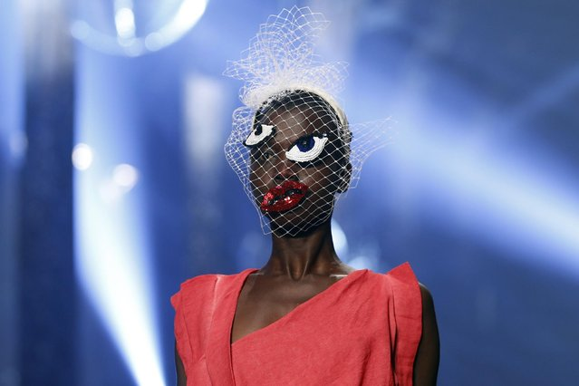 A model wears a creation for Vivienne Westwood's Spring-Summer 2016 ready-to-wear fashion collection, presented during the Paris Fashion Week in Paris, Saturday October 3, 2015. (Photo by Francois Mori/AP Photo)