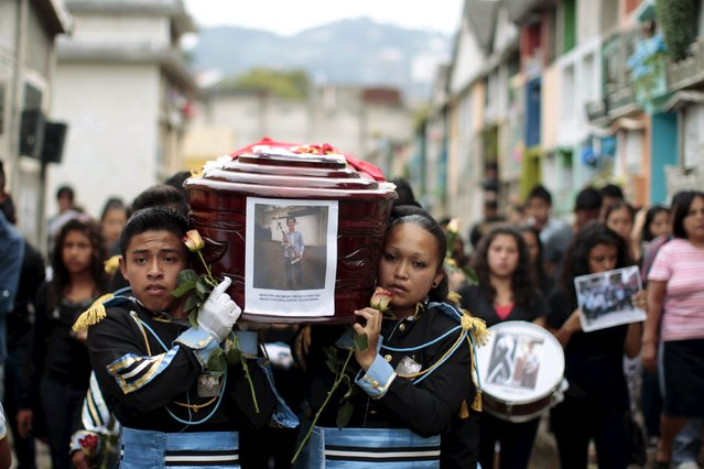 Bandmates participate in the funeral of Bryan Sandoval, a mudslide victim in Santa Catarina Pinula, on the outskirts of Guatemala City, October 4, 2015. (Photo by Josue Decavele/Reuters)