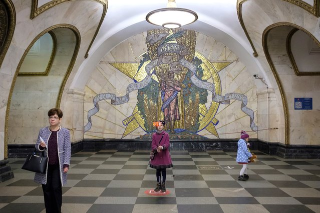 The Novoslobodskaya station on the circle has the distinction of being one of the favorite stations of Muscovites and tourists. It was opened in 1952 and symbolizes the greatness of socialism and the beauty of the Soviet homeland. (Photo by Didier Bizet/The Washington Post)