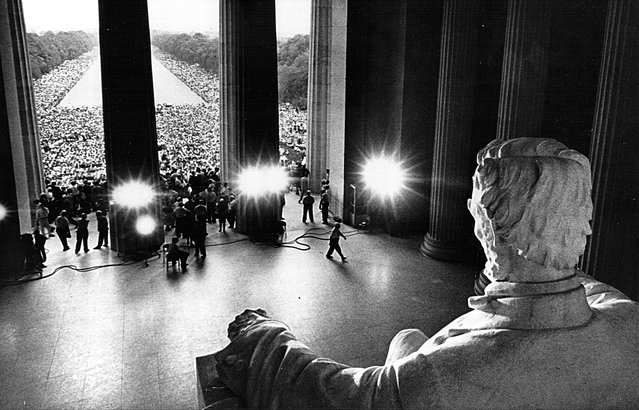 The statue of Abraham Lincoln is illuminated during a civil rights rally, on August 28, 1963 in Washington, D.C. (Photo by National Archive/Newsmakers)