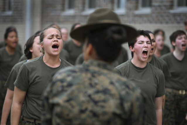 Drill Instructor SSgt. Jennifer Garza disciplines her Marine recruits with some unscheduled physical training in the sand pit outside their barracks during boot camp February 27, 2013 at MCRD Parris Island, South Carolina. Female enlisted Marines have gone through recruit training at the base since 1949. About 11 percent of female recruits who arrive at the boot camp fail to complete the training, which can be physically and mentally demanding. On January 24, 2013 Secretary of Defense Leon Panetta rescinded an order, which had been in place since 1994, that restricted women from being attached to ground combat units. About six percent of enlisted Marines are female. (Photo by Scott Olson/AFP Photo)