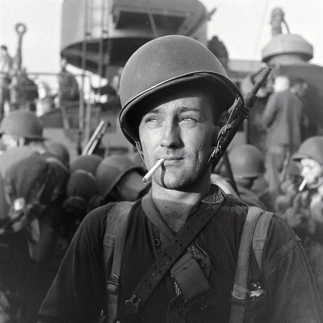 An American Marine readies to land on Guadalcanal during the five-month struggle for the island between late 1942 and early 1943. Three thousand miles south of Tokyo, Guadalcanal was a major shipping point for military supplies. The Allied victory there in February, 1943, marked a major turning point in the war after a string of Japanese victories in the Pacific. (Photo by Joe Scherschel/Time & Life Pictures)