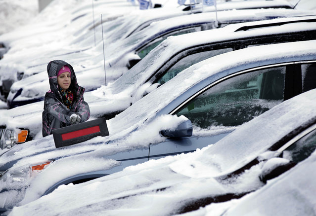 Jessica Halverson, a sales person at Heiser Ford Lincoln dealership on W. Silver Spring Dr. in Milwaukee works on clearing the snow off the cars in the lot on Wednesday, March 6, 2013. Snow piled up across the state Tuesday as a late-season storm with snow totals ranging from 8.9 inches in areas of Dane County to an official 4.1 inches at Mitchell International Airport in Milwaukee, according to the National Weather Service in Sullivan. After pummeling the nation's midsection with heavy snow, the late-winter storm made its way Wednesday to the nation's capital, where residents braced for the possibility of power outages. (Photo by Mike De Sisti/MDESISTI@JOURNALSENTINEL.COM)