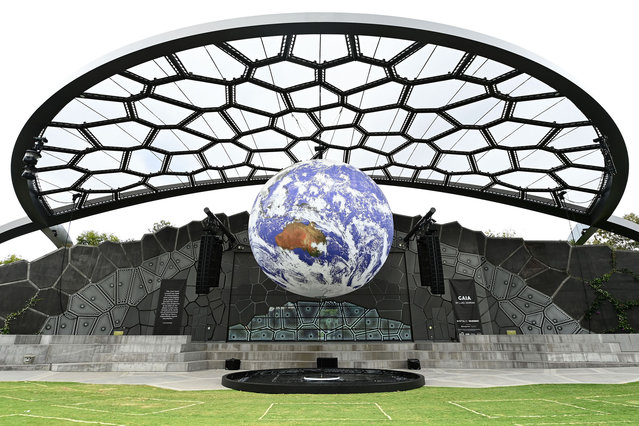 """Art installation """"Gaia"""" is seen on display at HOTA on September 30, 2020 in Gold Coast, Australia. The work by UK artist Luke Jerram measures seven metres in diameter, with internal lighting combining 120dpi detailed NASA imagery of the Earth. The spherical sculpture is accompanied by a specially made surround sound composition by composer Dan Jones. (Photo by Quinn Rooney/Getty Images)"""