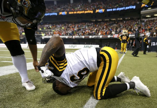 Hamilton Tiger Cats' Brandon Banks reacts after his touchdown was called back against the Calgary Stampeders during the CFL's 102nd Grey Cup football championship in Vancouver, British Columbia, November 30, 2014. (Photo by Todd Korol/Reuters)