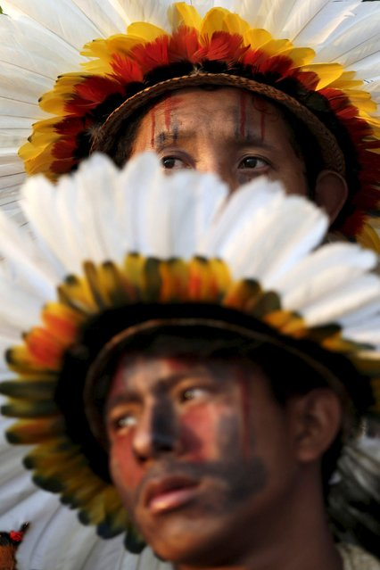 Indigenous men from the Erikbaktsa tribe watch a presentation of the various sporting disciplines included in the first World Games for Indigenous Peoples in Palmas, Brazil, October 24, 2015. (Photo by Ueslei Marcelino/Reuters)