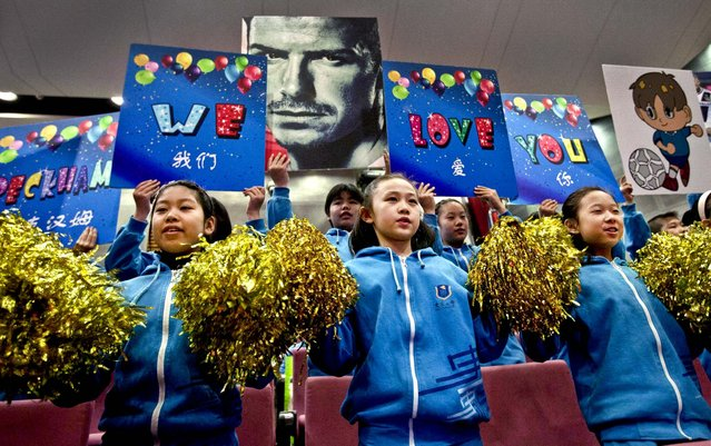 Students of Shijia Primary School rehearse their cheers before David Beckham arrives for a promotional event at the school in Beijing, on March 20, 2013. (Photo by Alexander F. Yuan/Associated Press)