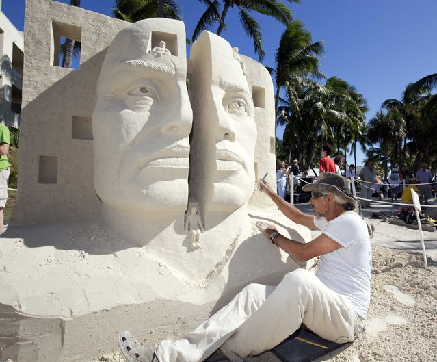 """Benjamin Probanza of Acapulco, Mexico, puts finishing touches on his sand sculpture """"Yin-Yang"""", at the International Sand Art Competition in Key West, Florida, November 29, 2014. Six accomplished sand art experts are competing in the event that is part of Art! Key West!, an island wide cultural celebration that ends Sunday. (Photo by Rob O'Neal/Reuters/Florida Keys News Bureau)"""