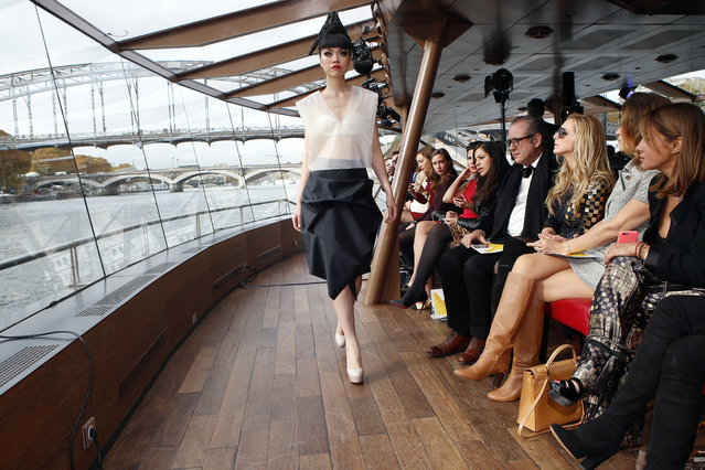 Jessica Minh Anh displays a creation as part of the Jessica Minh Anh Autumn Fashion Show on a floating catwalk set up in a boat cruising on the Seine river, in Paris, Thursday, October 29, 2015. (Photo by Francois Mori/AP Photo)