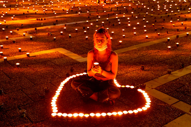 An Israeli attends a 25,000 candle vigil at Rabin Square in the Israeli coastal city Tel Aviv, on October 29, 2020, ahead of the 25th anniversary of the assassination of former Israeli Prime Minister Yitzhak Rabin, Rabin was gunned down in Tel Aviv after a peace rally on November 4, 1995 by a right-wing Jewish extremist Yigal Amir. (Photo by Jack Guez/AFP Photo)