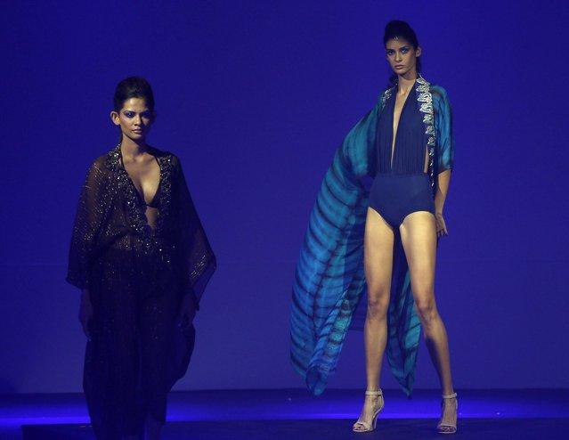 In this Wednesday, April 3, 2013 photo, models present creations by Aqua during Colombo Fashion Week in Colombo, Sri Lanka. (Photo by Eranga Jayawardena/AP Photo)