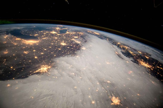This NASA photo obtained December 10, 2014 shows from the International Space Station, a photo taken by Expedition 42 Commander Barry Wilmore of the Great Lakes and central US on December 7, 2014. (Photo by Barry Wilmore/AFP Photo/NASA)