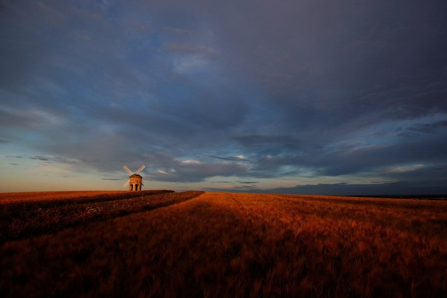The Chesterton Windmill is seen during sunrise in Chesterton, Britain on July 30, 2020. (Photo by Peter Cziborra/Reuters)