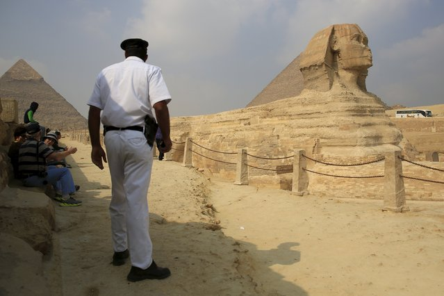 A policeman stands guard in front of the Sphinx at the Giza Pyramids on the outskirts of Cairo, Egypt, November 8, 2015. (Photo by Amr Abdallah Dalsh/Reuters)